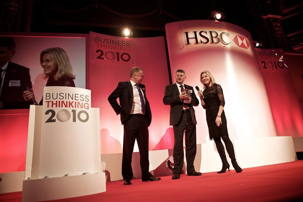 Laurence McDougall is presented with All Steels Trading's HSBC Business Thinking 2010 winner's trophy from ITN newsreader Mary Nightingale.